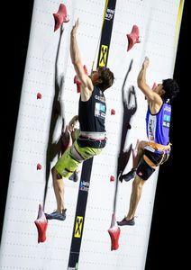 Jan Hojer of Germany Kokoro Fujii of Japan during the final of Men Combined competition, Speed of the IFSC Climbing World Championships 2018. Innsbruck, Austria, 2018/09/16