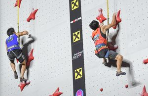 Rei Sugimoto of Japan YuFei Pan of China during the Mens Speed Climbing qualification for the IFSC Climbing World Championships 2018. Innsbruck, Austria, 13 September 2018