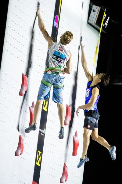 Jakob Schubert of Austria Kai Harada of Japan during the final of Men Combined competition, Speed of the IFSC Climbing World Championships 2018. Innsbruck, Austria, 2018/09/16