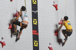 Carlos Granja of Ecuador Ka-chun Yau of Hong Kong during the Mens Speed Climbing qualification for the IFSC Climbing World Championships 2018. Innsbruck, Austria, 13 September 2018